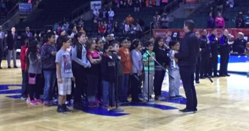 Students singing the national anthem